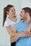 Happy young couple fitness workout and fun Royalty Free Stock Photography