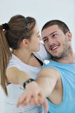 Happy young couple fitness workout and fun Stock Photos