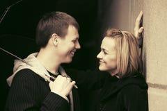 Happy young couple flirting on city street Stock Photos