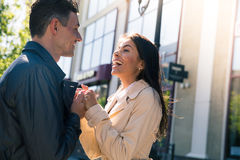 Happy young couple flirting outdoors Royalty Free Stock Photos