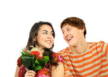 Happy young couple with flowers Royalty Free Stock Image