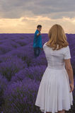 Happy young couple, follow me concept. Happy young couple on lavender field, follow me concept Stock Photo