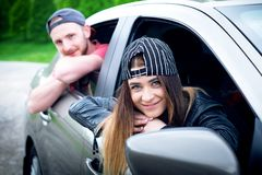 Happy young couple, friends making selfie while sitting in car. Summer time. Caucasian people. Concept of transportation. stock image