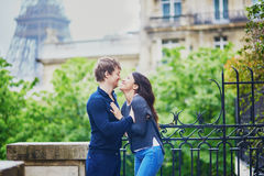 Happy young couple in front of the Eiffel tower Stock Photo