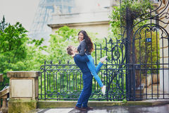 Happy young couple in front of the Eiffel tower Royalty Free Stock Photo
