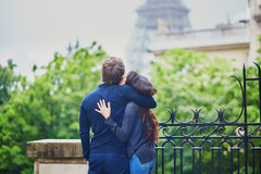Happy young couple in front of the Eiffel tower Stock Photography