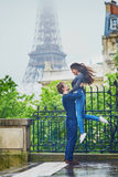 Happy young couple in front of the Eiffel tower Royalty Free Stock Photos
