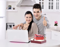 Happy young couple with gift boxes Stock Image