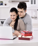 Happy young couple with gift boxes Royalty Free Stock Photography