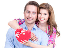 Happy young couple with a gift. Stock Images