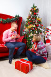 Happy young couple with gifts at New Year Stock Photo