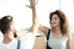 Happy and young couple giving a high five Royalty Free Stock Image