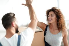 Happy and young couple giving a high five Royalty Free Stock Photo