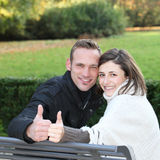 Happy young couple giving a thumbs up Royalty Free Stock Photo