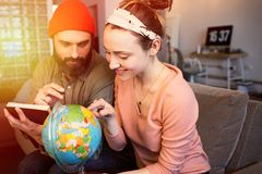 Happy young couple with globe choosing place for summer rest at leisure. Travel concept. Happy young couple with globe choosing place for summer rest at leisure royalty free stock image