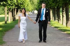 Happy young couple go to alley Royalty Free Stock Image