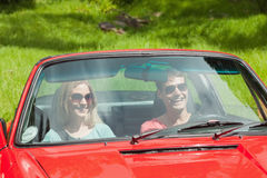 Happy young couple going for a ride together Royalty Free Stock Image