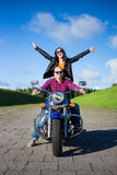 Happy young couple going to travel on motorbike Stock Photos