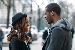 Happy young couple. Good news for black male stock images