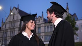Happy young couple on graduation day smiling to camera. stock video
