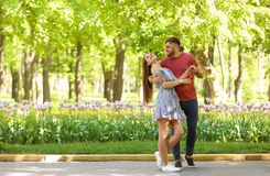 Young couple in green park on sunny spring day Royalty Free Stock Image