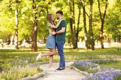 Young couple in green park on sunny spring day Stock Images