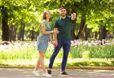 Young couple in green park on sunny spring day Stock Image