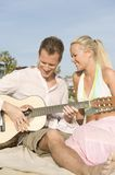 Happy Young Couple With Guitar Royalty Free Stock Photography
