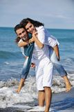 Happy Young Couple Have Fun At Beautiful Beach Royalty Free Stock Photography