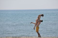 Happy young couple have fun on beach Royalty Free Stock Image