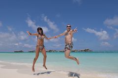 Happy young couple have fun on beach Stock Photography