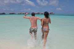 Happy young couple have fun on beach Stock Image