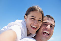 Happy young couple have fun on beach Royalty Free Stock Images
