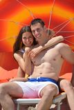 Happy young couple have fun on beach Stock Photos