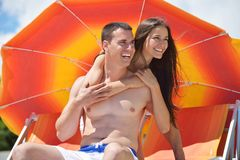 Happy young couple have fun on beach Royalty Free Stock Photography