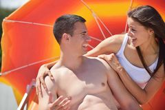Happy young couple have fun on beach Stock Images