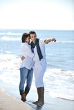 Happy young couple have fun at beautiful beach Stock Photo
