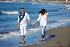 Happy young couple have fun at beautiful beach Royalty Free Stock Photos