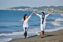 Happy young couple have fun at beautiful beach Royalty Free Stock Photo