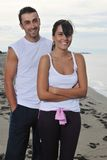 Happy young couple have fun at beautiful beach Stock Image