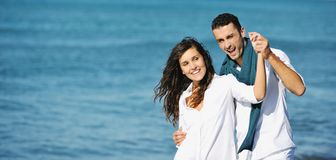 Happy young couple have fun at beautiful beach Stock Images