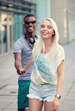 Happy young couple have fun in the city summertime Stock Images