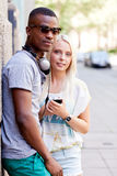 Happy young couple have fun in the city summertime Stock Photo