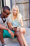 Happy young couple have fun in the city summertime Stock Photography