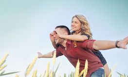 Happy young couple have fun at the field in summer, happy future royalty free stock images