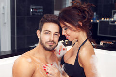 Happy young couple have fun in jacuzzi Stock Photography