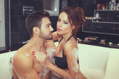 Happy young couple have fun in jacuzzi Royalty Free Stock Photography