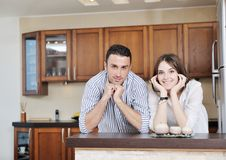 Happy young couple have fun in modern kitchen Royalty Free Stock Images