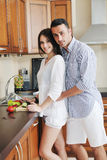 Happy young couple have fun in modern kitchen Royalty Free Stock Photos