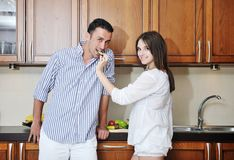 Happy young couple have fun in modern kitchen Royalty Free Stock Photo
